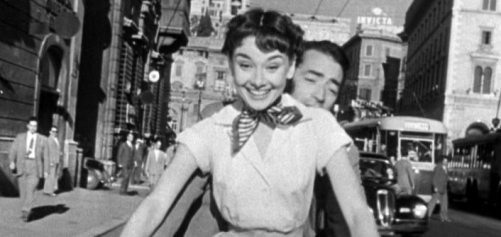 90a01-audrey_hepburn_and_gregory_peck_on_vespa_in_roman_holiday_trailer.jpg