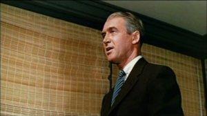 Vertigo_1958_trailer_Stewart_on_a_laddder