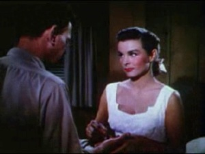 Jean_Peters_mends_Joseph_Cotten's_hand_in_Niagara_trailer_1